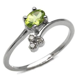Srebrny pierścionek naturalny perydot i diamenty 0,49 ct
