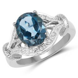 Srebrny pierścionek z okazałym naturalnym topazem London Blue i diamentami 3,26 ct