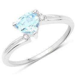 Srebrny pierścionek z topazem niebieskim i diamentami 0,82 ct